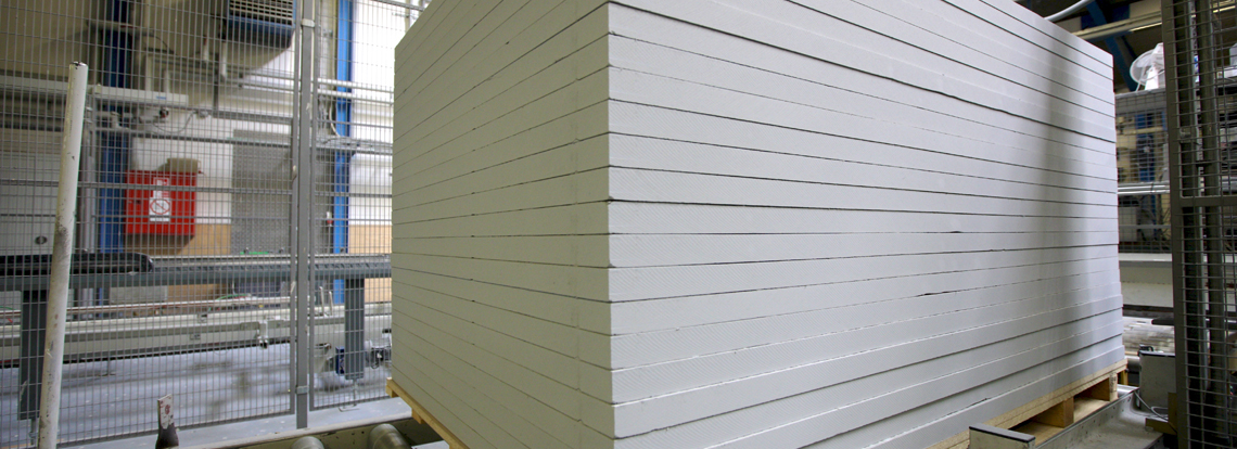 Stack of Skamol calcium silicate boards ready
